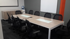 Boardroom table with metal legs and glass inlays