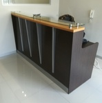 Reception counter with raised glass top